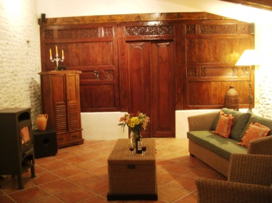 The sitting room with antique carved wooden panel and door
