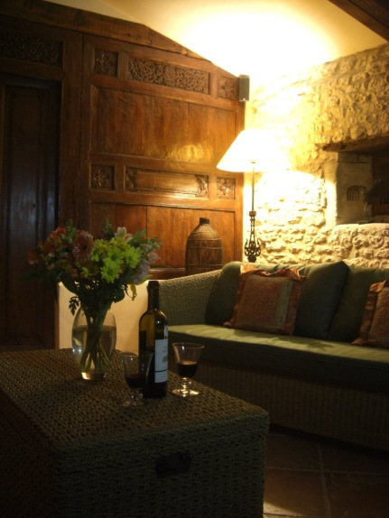 Relax with a glass of wine in the villa's sitting room.